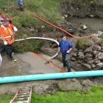Scott M assisting with pipe crossing repair
