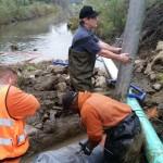 Kevin Cullen repairing pipe crossing
