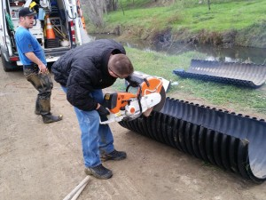 Shane custom fitting corrugated plastic pipe to cover sewer line