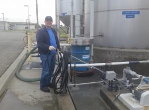 FSSD staff Gary C washing down equipment